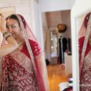 Finishing touches are added to the bride in her gorgeous Indian sari before the Hindu ceremony at Rancho del Cielo, Malibu, California.