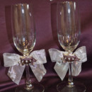 130x130 sq 1388705684618 white bows with gold coache