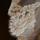 close-up of Alencon re-embroidered detail