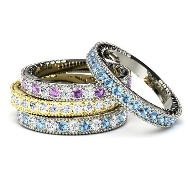 <b>Victoria Band</b><br>This band with gems halfway around has a beautifully engraved pattern on each side. Available in twenty-two gemstones.