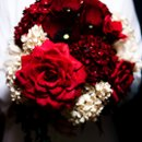 large paper flower bouquet from thecrimsonpoppy.com - paper hydrangeas in deep wine red and ivory, oriental poppies in deep wine red, peonies in ivory, ivy vines, and roses and duchess rose hand-dyed in wine red all photos (c) the crimson poppy - all rights reserved