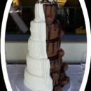 130x130 sq 1382254382674 mooshus wedding cake bride half groom1