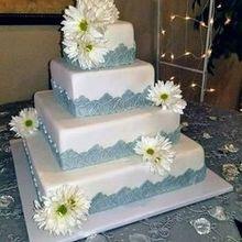 220x220 sq 1508382451 762db7039b858657 mooshus 4 tier fondant silver molded lace square daisies weddi
