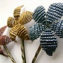 A trio of beaded flowers on bobby pins. You can customize these in any colour ans as many as you like.