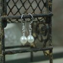 Sugar Drops Earrings CLASSIC...that's the best way to describe these earrings. That one pair of pearl earrings everyone should own because they aren't flashy and just go with everything. Dainty, sugary cream freshwater pearls that I hand wrapped on sterling silver earwires. All silver components are sterling silver. Length (including earwires) - 1