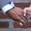 130x130 sq 1444612407035 bg hand holding