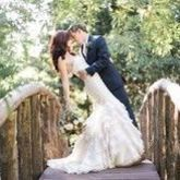 220x220 sq 1509482079 0cb2803d44536876 1494095700138 groom kissing brise on hidden creek bridge