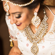 220x220 sq 1473053338902 05bride decorated in her gold necklace ear rings a
