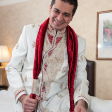 220x220 sq 1473053550291 05groom getting ready in his hotel room