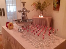 220x220 1473354704926 1473354684273 champagne fountain and flutes