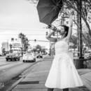 130x130 sq 1492321906226 bride with umbrella on las vegas strip