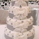 130x130 sq 1284428095492 weddingcakewhiteribbons