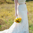 130x130 sq 1395800821356 bride with yellow bouque
