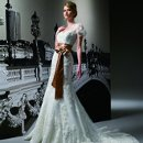 T180 Strapless sweetheart gown with beaded lace appliques throughout bodice and skirt. Includes beaded lace jacket and ribbon sash.