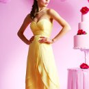B3031 Strapless sweetheart gown with pleated bodice, vertical pleated empire band and layered skirt. Spring 2010 Collection