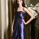 l3072 Strapless gown with ruched front and beaded flower accent at waist. Also available in tea-length and floor-length. Fall 2010 Collection