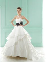 F141011 Strapless sweetheart neckline with detachable accent bow waistband and tiered skirt.
