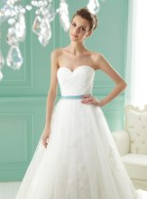 F141012 Strapless sweetheart neckline with detachable accent ribbon sash and lace embellishment on skirt.