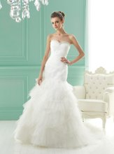 F141015 Beaded strapless sweetheart neckline with pleated and ruffled skirt.
