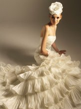 F420 Strapless modified sweetheart neckline with detachable beaded sash and layered ruffled skirt.