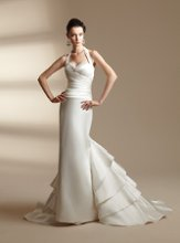 T142005 Beaded halter neckline with gathered bodice and ruffle insert in train.
