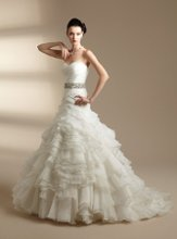 T142013 Strapless sweetheart neckline with beaded waistband and ruffled skirt.