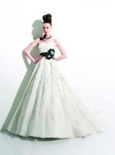 T383 Strapless sweetheart gown with flowers and embroidery on bodice and skirt. Includes waistband and flower pin.