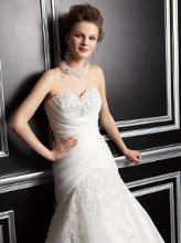 T142060 Strapless sweetheart neckline with corset back. Pleats on bodice with beaded lace throughout bodice and skirt.