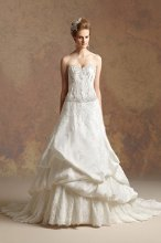 T152021 Lace A-line gown with pick-up skirt and corset style bodice with beaded accents on waistline and neckline.