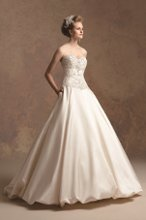 T152005 Ball gown with fully beaded and embroidered bodice. Skirt features pockets and optional bubble hem.