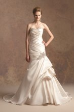 T152007 Mermaid gown with ruched bodice, pick-ups in skirt, and beaded accents on hip, front neckline, and back neckline.