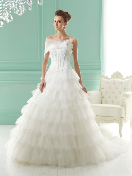 F141018  Strapless sweetheart neckline with corset bodice and tiered skirt. Includes accessory jacket.
