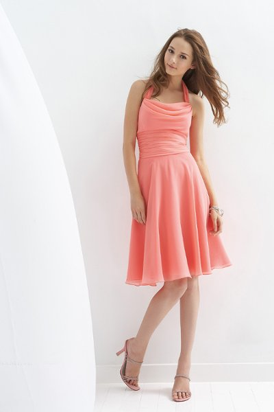 Style B143001   Available in knee, tea, or floor length. Gathered neckline with pleated waistline and plain skirt.