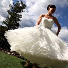 220x220 sq 1382926852283 bride twirli