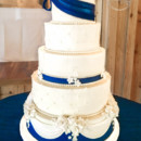 130x130 sq 1473348464818 navy and blue wedding cake with fondant bow flower