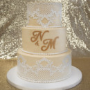 130x130 sq 1473348465040 lace wedding cake with gold monogram and cake lace