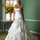 Style J6232 Luminous taffeta fit and flare features soft layers throughout the skirt. The drop waist and bodice are adorned with silver embroidery, beadeing, and pearl detailing. Finished with a corset closure.
