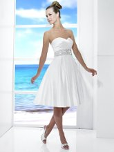 Style: T 473 The Little White Dress or the LWD is the hottest thing! This short gown features pockets in the front and is perfect for that destination wedding or reception dress.