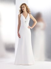 Style T545 This trumpet, deep v-neck chiffon is perfect for a destination wedding. The back makes a statement with its trailing chiffon tails and keyhole back. The empire waist is accented with beaded detailing.