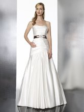 Style T570 This satin fit and flare gown features a neckline that gently dips into a sweetheart and a beaded ribbon sash.