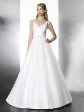 Style: T581 This subtle ball gown features a V-neckline and beaded straps. Finished with a beaded strap at the waist.