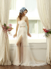 H 1226 Fall 2013 Soft organza is draped over rich alencon lace fabric to create a romantic slit in this fit and flare. The Swarovski accented beaded sash that ties around the asymmetric waist is included.