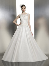 T636 A rich satin ball gown with alencon lace and beaded accents along the sheer bateau neckline and bodice.
