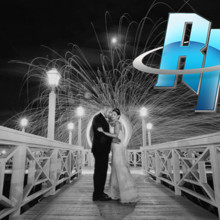 220x220 sq 1408397771394 romantic wedding photo with fire copy