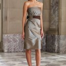 BY2992T Strapless taffeta knee-length sheath with wrapped skirt, ruched waistband features side hand-beaded accent and back bow, back zipper. Matching shawl (not shown) and removable straps included. Available in all taffeta colors.