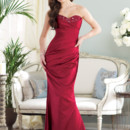 Style BY21387 <br /> Strapless satin slim A-line gown with sweetheart bust line encrusted with hand-beading, asymmetrically draped bodice with asymmetrically dropped waistline, corset back, back flared skirt. Removable straps included. Available in all satin colors. Color shown: Claret