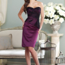 Style BY21395TStrapless satin, tulle and lace knee-length sheath with sweetheart neckline, asymmetrically draped tulle bodice features scattered hand-beaded lace appliqués and soft asymmetrical peplum, corset back. Removable straps included. Available in all satin colors with only Black or Ivory tulle and lace. Color shown: Grape/Black