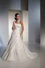 Y21167Z - Vanna  Make a grand entrance with this Monet taffeta and ornate lace gown, which features a softy curved strapless neckline. An asymmetrically draped band runs across the bodice and is accentuated with gorgeous three-dimensional lace appliqués. The lace appliqués spill down the side of the asymmetrically pleated bodice and onto the tulle inset of the skirt. Covered buttons on the dipped back bodice trail down the chapel length train finished with matching lace appliqués. Removable straps are included. Also available with functional corset back bodice as Y21167. Neck accessory sold separately as AY012.