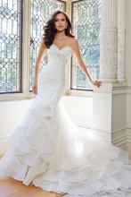 Y21437 - Sally 2014 Collection – Ruffles of fantasy organza are the main feature in Sally but the beauty doesn't end there. This strapless mermaid gown also offers a sweetheart neckline accentuated with crystal hand-beaded lace appliqués that trail down the side of the asymmetrically draped bodice with an asymmetrically dropped waistline. Layers of rich ruffles highlight the skirt and chapel length train.