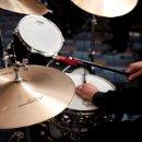 130x130_sq_1309193789638-drumsclose